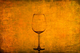 Empty wine glass on nice rusty vintage texture
