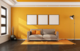Modern living room with orange wall