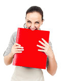 business woman bites in a red binder
