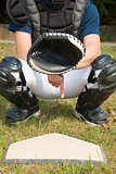 baseball catcher showing secret signal gesture