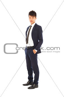 handsome businessman standing and hands in his pockets