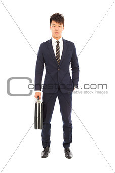 businessman holding a briefcase and hand in his pocket