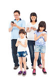 Asian Family standing and using smart phone together