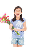 smiling little girl holding a bouquet carnation