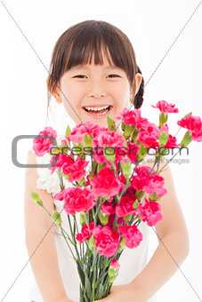 close up of happy little girl holding  a bouquet of carnations