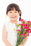 close up of little girl holding  a bouquet of carnations