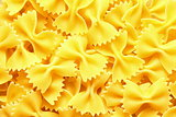 Italian Farfalle Pasta raw food background