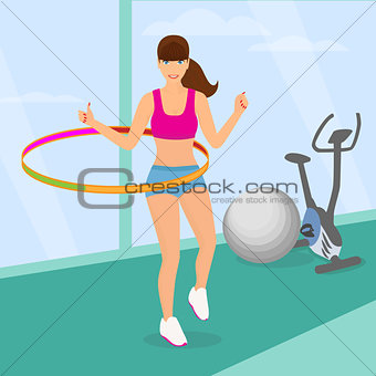 beautiful woman exercisingwith hula hoop in the gym