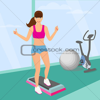 Beautiful woman doing aerobic workout with stepper platform in the gym