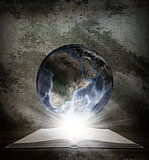 Over an open book is planet earth