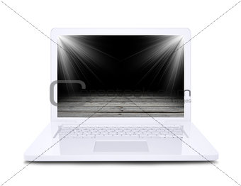 On the laptop screen shows a wooden floor floodlit