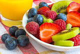 ripe berry and kiwi with orange juice