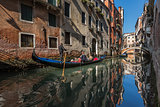Traditional Venice Gandola Ride along Narrow Canal, Venice, Ital