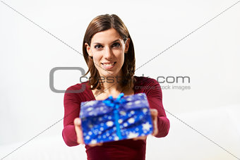 happy girl holding gift box to the camera