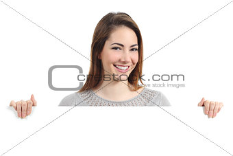 Beautiful happy woman smiling and holding a blank placard