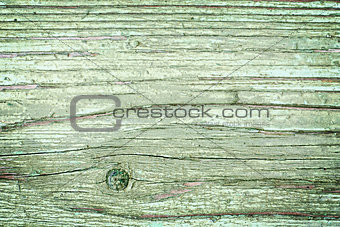 Old cracked painted texture. Rusty green wood.