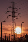 High voltage pole with lanterns at sunset
