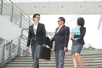 Asian business team meeting