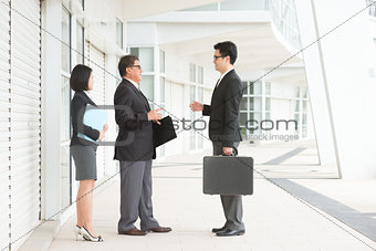Asian business team discussion