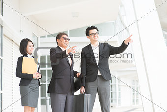 Asian business team over office