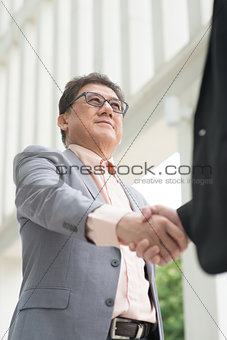 Asian businessmen handshaking