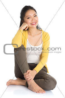 Asian girl sitting on floor