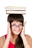 young beautiful girl in glasses with books on head. isolated on