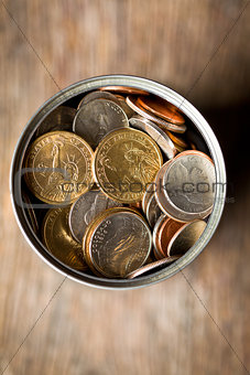 american coins in tin can