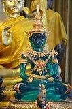 green buddha among other buddhas