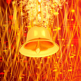 Gold bell on winter or Christmas style background