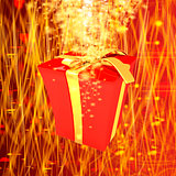 red gift box with golden ribbon on fantastic background