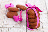 stack of chocolate cookies tied with pink ribbon