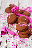 fresh chocolate cookies, coffee beans, pink ribbons and confetti