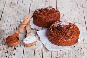 fresh baked browny cakes, sugar and cocoa powder