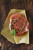 piece of raw meat beef steak with spices herbs