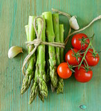 fresh green organic asparagus on a wooden background