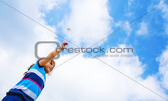 Little girl with kite outdoors
