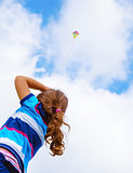 Little girl with windy kite