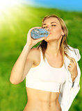 Healthy woman drinks water