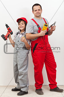 Boy helping his father with some electrical work