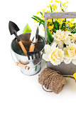 Flowers and working tools for gardening or flower-growing