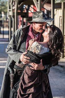 Gruff Man and Woman Kiss