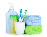 Toothbrushes, cosmetics bottles and towel