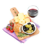 Red wine with cheese, bread, olives and spices
