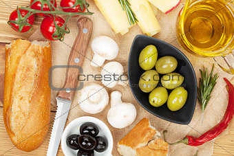 Olives, mushrooms, bread, vegetables and spices