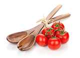 Ripe tomatoes and kitchen utensils