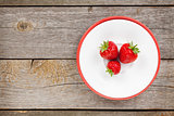 Plate with ripe strawberry