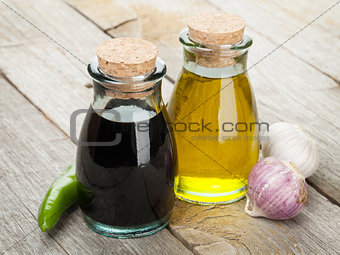 Olive oil and vinegar bottles with spices