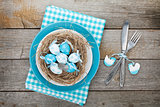 Easter eggs nest on plate