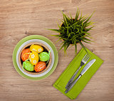 Easter eggs with silverware and potted flower